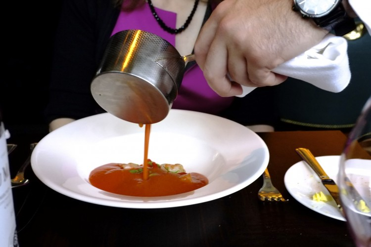 Gazpacho pored at the table